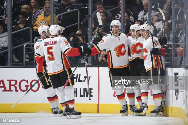 Dougie Hamilton Mikael Backlund and Mark Giordano of the Calgary Flames celebrate a goal against the Los Angeles Kings at STAPLES Center on October...