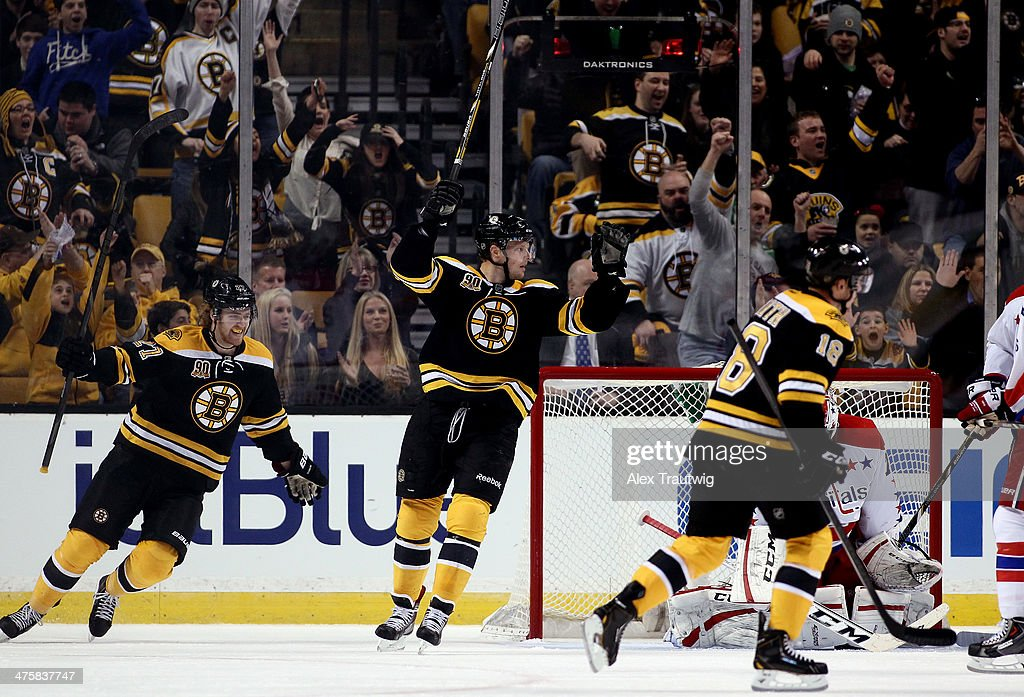 <a gi-track='captionPersonalityLinkClicked' href=/galleries/search?phrase=Dougie+Hamilton&family=editorial&specificpeople=6686524 ng-click='$event.stopPropagation()'>Dougie Hamilton</a> #27 of the Boston Bruins and Carl Soderberg #34 celebrate a second period goal by Patrice Bergeron #37 (not pictured) against the Washington Capitals during a game at the TD Garden on March 1, 2014 in Boston, Massachusetts.