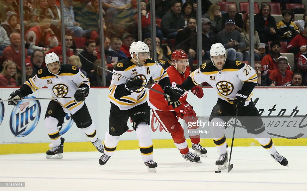<a gi-track='captionPersonalityLinkClicked' href=/galleries/search?phrase=Dougie+Hamilton&family=editorial&specificpeople=6686524 ng-click='$event.stopPropagation()'>Dougie Hamilton</a> #27 of the Boston Bruins carries the puck to center ice as <a gi-track='captionPersonalityLinkClicked' href=/galleries/search?phrase=Justin+Abdelkader&family=editorial&specificpeople=2271858 ng-click='$event.stopPropagation()'>Justin Abdelkader</a> #8 of the Detroit Red Wings gives chase during the third period of the game at Joe Louis Arena on November 27, 2013 in Detroit, Michigan. The Red Wings defeated the Bruins 6-1.