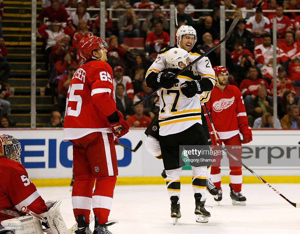 <a gi-track='captionPersonalityLinkClicked' href=/galleries/search?phrase=Dougie+Hamilton&family=editorial&specificpeople=6686524 ng-click='$event.stopPropagation()'>Dougie Hamilton</a> #27 of the Boston Bruins celebrates a game-winning overtime goal by <a gi-track='captionPersonalityLinkClicked' href=/galleries/search?phrase=Jarome+Iginla&family=editorial&specificpeople=201792 ng-click='$event.stopPropagation()'>Jarome Iginla</a> (not pictured) with Milan Lucic #17 against the Detroit Red Wings Game Four of the First Round of the 2014 NHL Stanley Cup Playoffs at Joe Louis Arena on April 24, 2014 in Detroit, Michigan. Boston won the game 3-2.