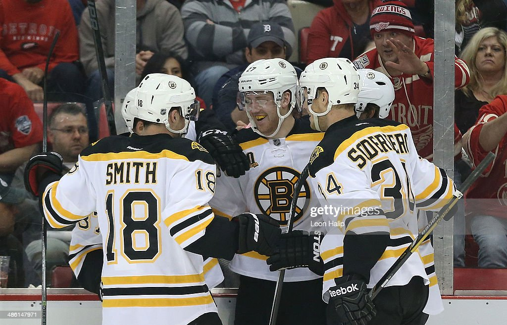 Dougie Hamilton #27 of the Boston Bruins celebrates after scoring a first-period goal against the Detroit Red Wings in Game Three of the First Round of the 2014 NHL Stanley Cup Playoffs at Joe Louis Arena on April 22, 2014 in Detroit, Michigan.