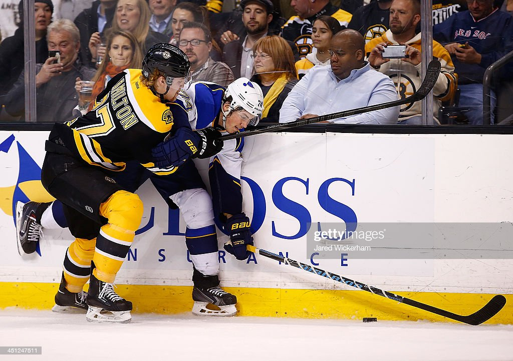 <a gi-track='captionPersonalityLinkClicked' href=/galleries/search?phrase=Dougie+Hamilton&family=editorial&specificpeople=6686524 ng-click='$event.stopPropagation()'>Dougie Hamilton</a> #27 of the Boston Bruins checks <a gi-track='captionPersonalityLinkClicked' href=/galleries/search?phrase=T.J.+Oshie&family=editorial&specificpeople=700383 ng-click='$event.stopPropagation()'>T.J. Oshie</a> #74 of the St Louis Blues along the boards in the second period at TD Garden on November 21, 2013 in Boston, Massachusetts.