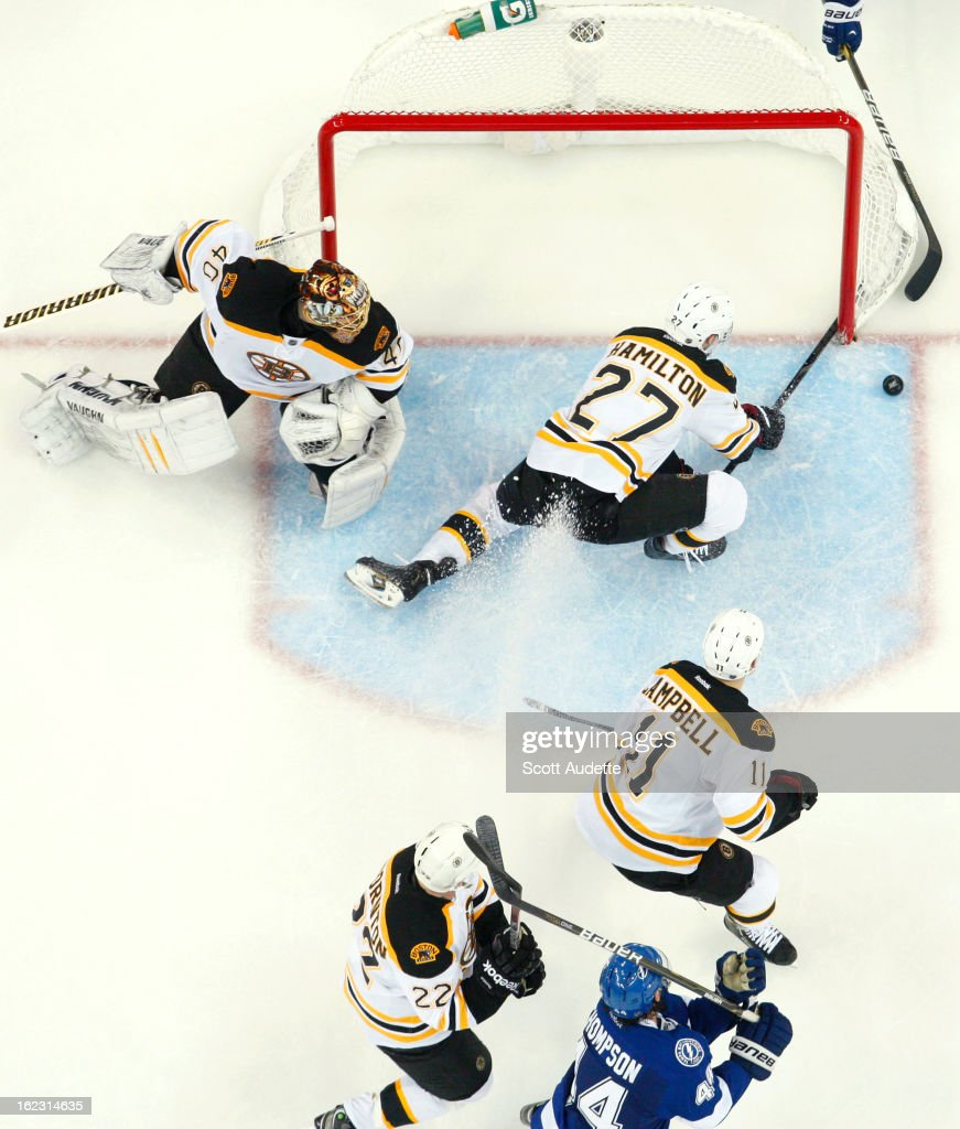 Dougie Hamilton #27 of the Boston Bruins dives to try and block a puck during the second period of the Tampa Bay Lightning game against the Boston Bruins at the Tampa Bay Times Forum on February 21, 2013 in Tampa, Florida.
