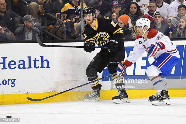 Dougie Hamilton of the Boston Bruins passes the puck against Max Pacioretty of the Montreal Canadiens at the TD Garden on February 8 2015 in Boston...