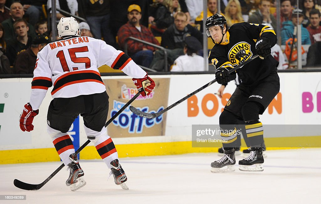 Dougie Hamilton #27 of the Boston Bruins passes the puck against the New Jersey Devils at the TD Garden on January 29, 2013 in Boston, Massachusetts.