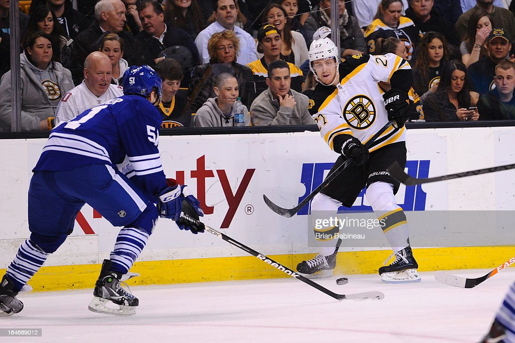 Dougie Hamilton #27 of the Boston Bruins passes the puck against the Toronto Maple Leafs at the TD Garden on March 25, 2013 in Boston, Massachusetts.