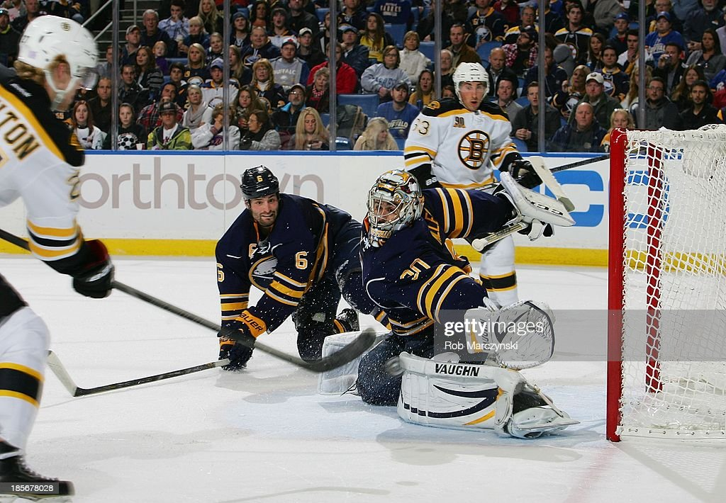 <a gi-track='captionPersonalityLinkClicked' href=/galleries/search?phrase=Dougie+Hamilton&family=editorial&specificpeople=6686524 ng-click='$event.stopPropagation()'>Dougie Hamilton</a> #27 of the Boston Bruins scores a second period goal against Ryan Miller #30 of the Buffalo Sabres on October 23, 2013 at the First Niagara Center in Buffalo, New York.