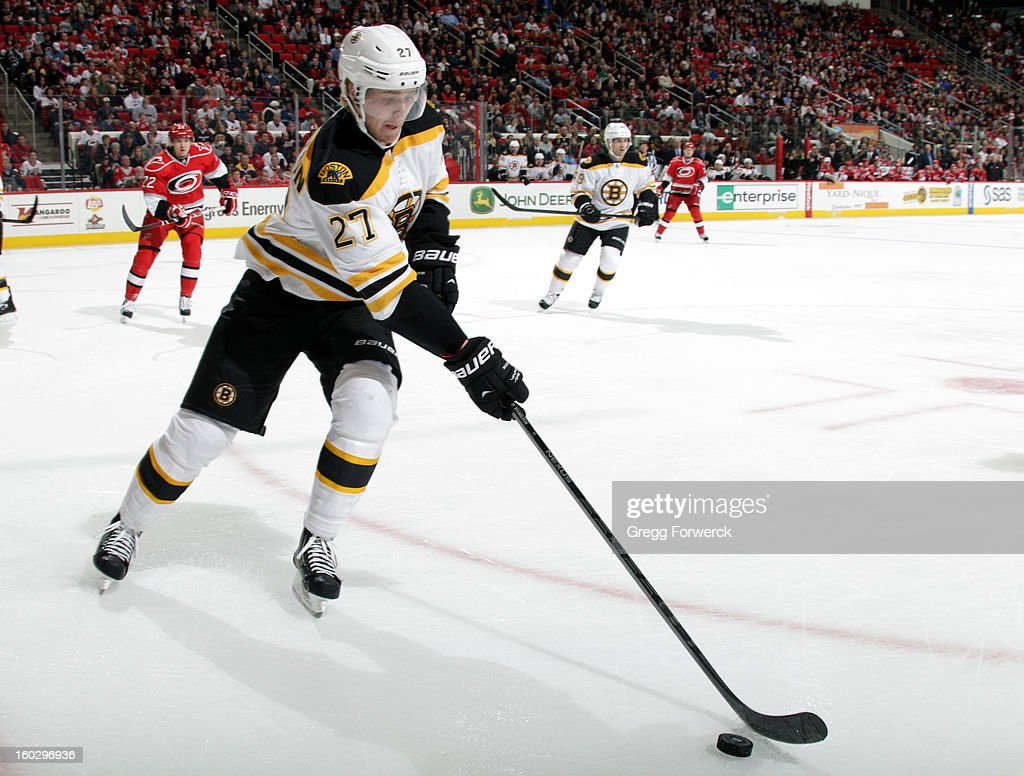 Dougie Hamilton #27 of the Boston Bruins skates into the corne to collect the puck during an NHL game against the Carolina Hurricanes on January 28, 2013 at PNC Arena in Raleigh North Carolina.