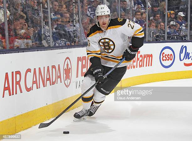 Dougie Hamilton of the Boston Bruins skates with the puck against the Toronto Maple Leafs during an NHL game at the Air Canada Centre on October 25...