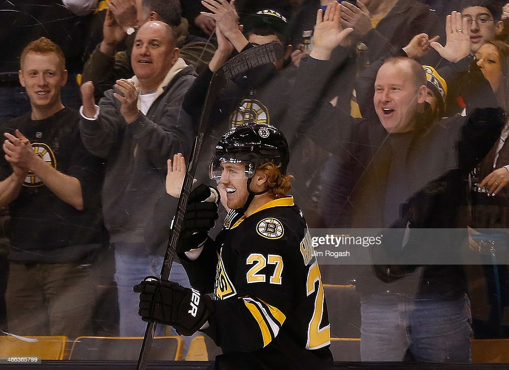 Dougie Hamilton #27 of the Boston Bruins smiles after he scored against the Edmonton Oilers in the 3rd period at TD Garden on February 1, 2014 in Boston, Massachusetts.