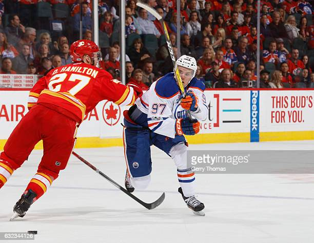 Dougie Hamilton of the Calgary Flames battles against Connor McDavid of the Edmonton Oilers at Scotiabank Saddledome on January 21 2017 in Calgary...