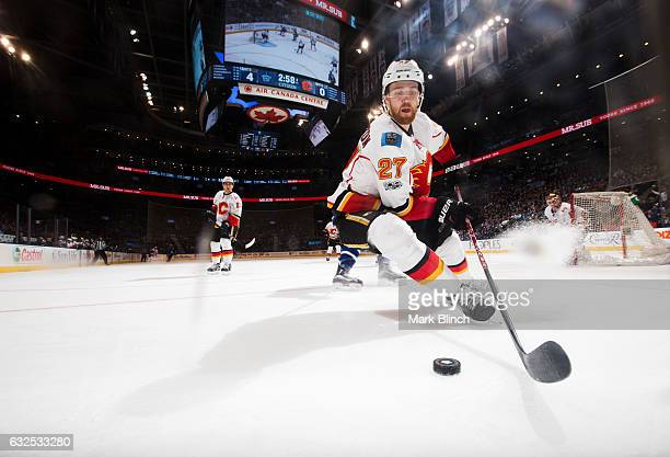 Dougie Hamilton of the Calgary Flames comes in to clear the puck against the Toronto Maple Leafs during the third period at the Air Canada Centre on...