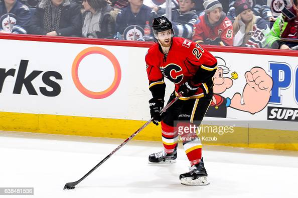 Dougie Hamilton of the Calgary Flames plays the puck along the boards during third period action against the Winnipeg Jets at the MTS Centre on...