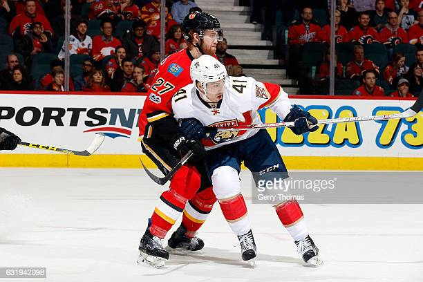 Dougie Hamilton of the Calgary Flames skates against Greg McKegg of the Florida Panthers during an NHL game on January 17 2017 at the Scotiabank...