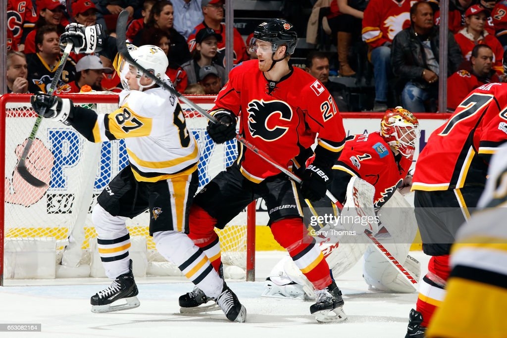 Dougie Hamilton #27 of the Calgary Flames skates against Sidney Crosby #87 of the Pittsburgh Penguins during an NHL game on March 13, 2017 at the Scotiabank Saddledome in Calgary, Alberta, Canada.
