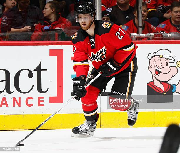 Dougie Hamilton of the Calgary Flames skates against the Boston Bruins at Scotiabank Saddledome on December 4 2015 in Calgary Alberta Canada