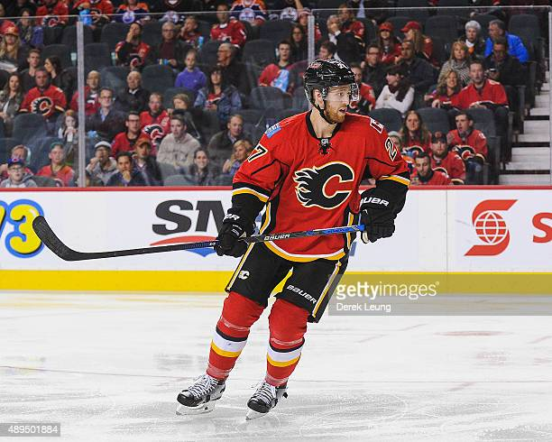 Dougie Hamilton of the Calgary Flames skates against the Edmonton Oilers during a preseason NHL game at Scotiabank Saddledome on September 21 2015 in...