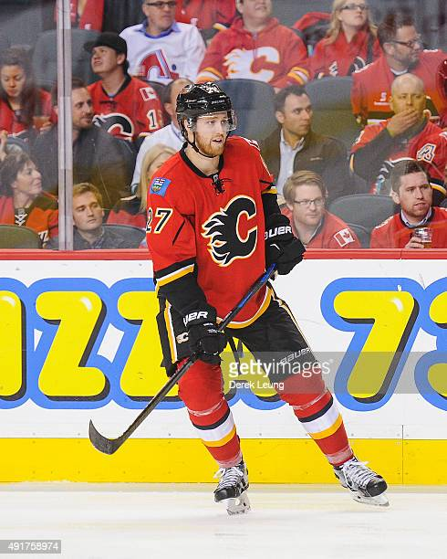 Dougie Hamilton of the Calgary Flames skates against the Vancouver Canucks in the season opener at Scotiabank Saddledome on October 7 2015 in Calgary...