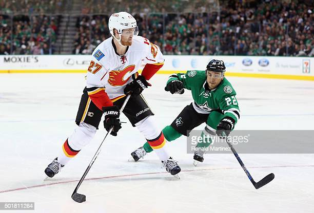 Dougie Hamilton of the Calgary Flames skates the puck against Colton Sceviour of the Dallas Stars in the second period at American Airlines Center on...