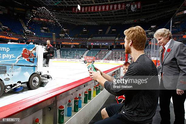 Dougie Hamilton of the Calgary Flames sprays water on a zamboni before an NHL game against the Washington Capitals on October 30 2016 at the...