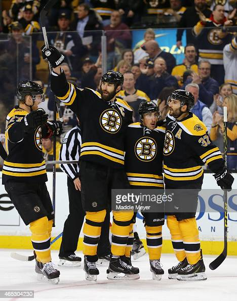 Dougie Hamilton Zdeno Chara and Patrice Bergeron congratulate Brad Marchand of the Boston Bruins after he scored a goal against the Calgary Flames...