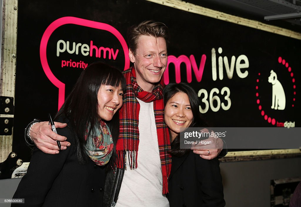 Dougie Payne of Travis takes photos with fans after performing songs from the new album 'Everything At Once' at HMV Oxford Street on April 30, 2016 in London, England.