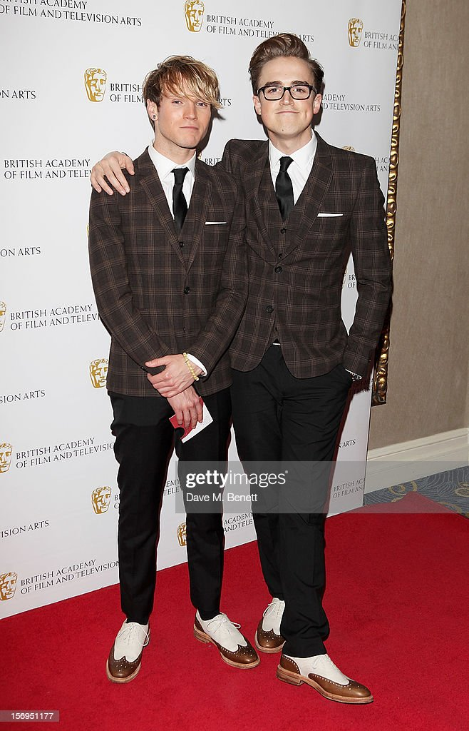 <a gi-track='captionPersonalityLinkClicked' href=/galleries/search?phrase=Dougie+Poynter&family=editorial&specificpeople=214057 ng-click='$event.stopPropagation()'>Dougie Poynter</a> (L) and Tom Fletcher arrive at the British Academy Children's Awards at the London Hilton on November 25, 2012 in London, England.