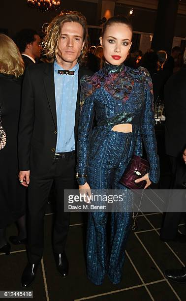 Dougie Poynter and Xenia Tchoumi attend the IWC Schaffhausen Dinner in Honour of the BFI at Rosewood London on October 4 2016 in London England