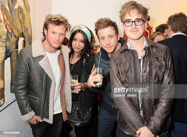 Dougie Poynter Lara CarewJones Danny Jones and Tom Fletcher attend the Loughran Gallery popup opening party at The Gallery in Redchurch Street on...
