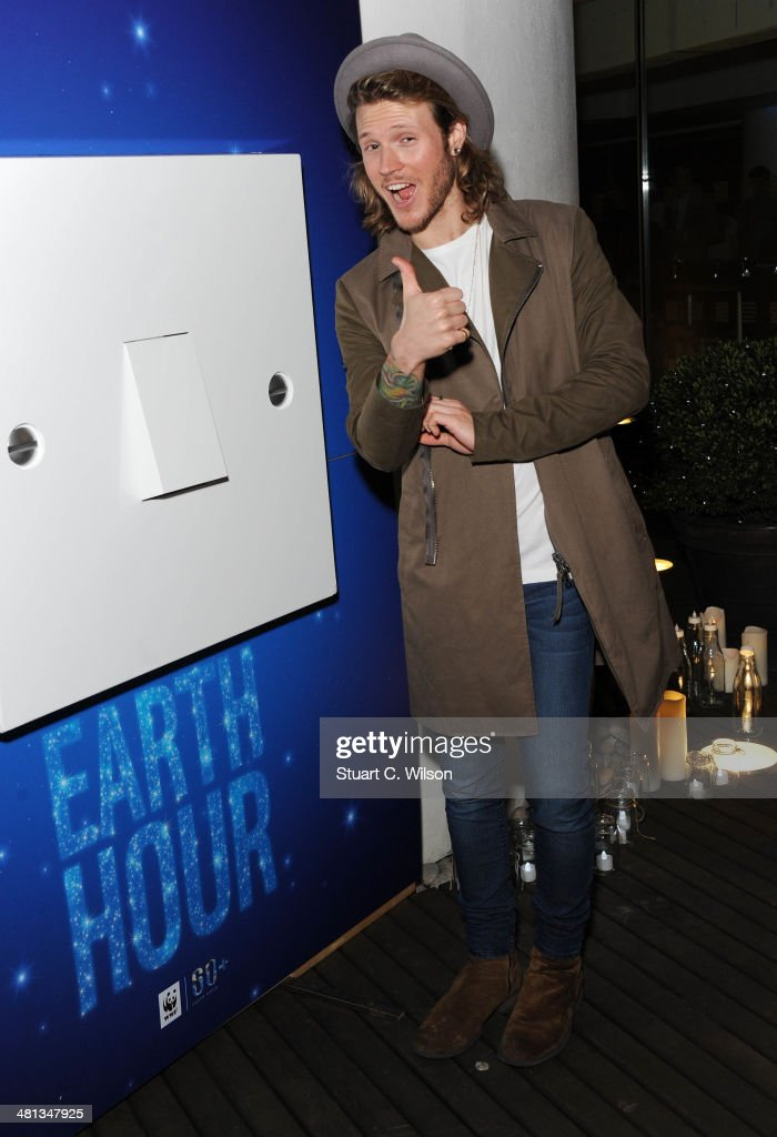 <a gi-track='captionPersonalityLinkClicked' href=/galleries/search?phrase=Dougie+Poynter&family=editorial&specificpeople=214057 ng-click='$event.stopPropagation()'>Dougie Poynter</a> poses prior to a candlelight performance by Sophie Ellis Bextor for the WWF Earth Hour at Southbank Centre on March 29, 2014 in London, England.