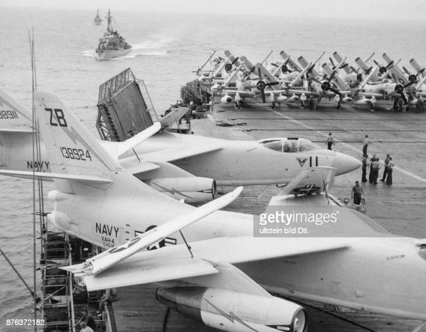A Douglas A3 Skywarrior and a Douglas A1H Skyraider on the flight deck of the aircraft carrier USS Hancock Claude Jacoby