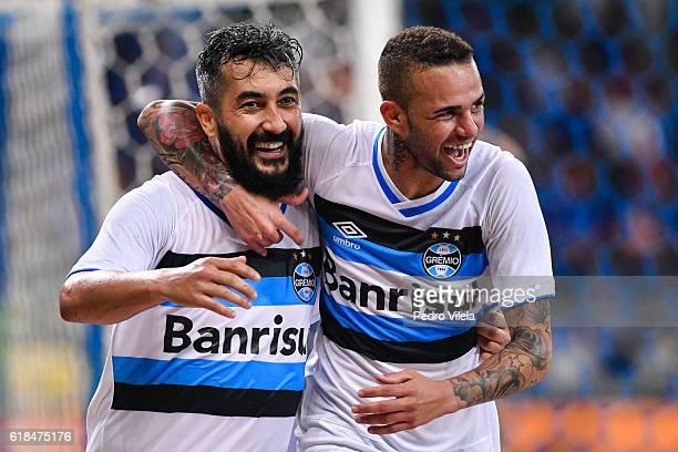 Douglas and Luan of Gremio celebrates a scored goal against Cruzeiro during a match between Cruzeiro and Gremio as part of Copa do Brasil SemiFinals...