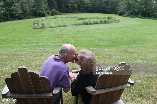 Douglas and Patricia Coldwell who have been married nearly 50 years kiss on a hillside where Doug planted a huge heartshaped testament to their love...
