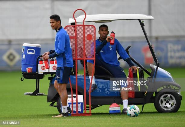 Douglas and Walace look on during a training session of Hamburger SV on August 31 2017 in Hamburg Germany