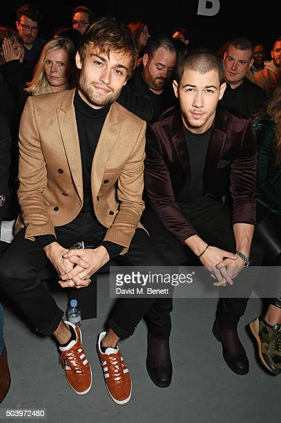 Douglas Booth and Nick Jonas attend the TOPMAN Design Front Row during London Collections Men AW16 at Topman Show Space on January 8 2016 in London...