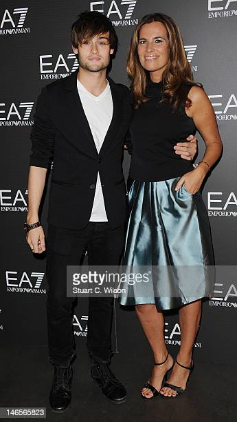 Douglas Booth and Roberta Armani attend the Emporio Armani Summer Garden Live 2012 Party at Emporio Armani on June 19 2012 in London England