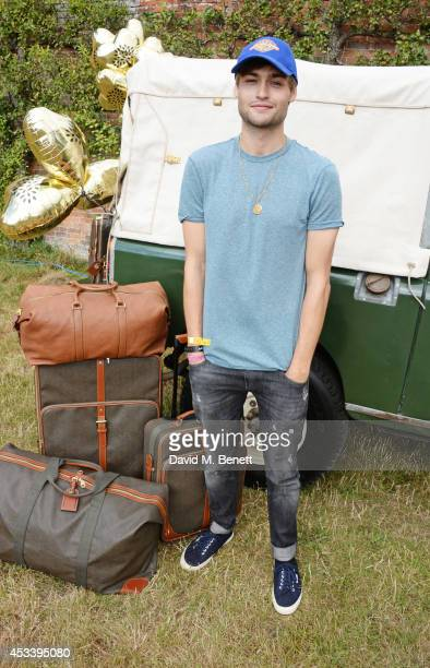 Douglas Booth attends The Mulberry Wilderness Picnic with Cara Delevingne during Wilderness 2014 at Cornbury Park on August 9 2014 in Oxford England