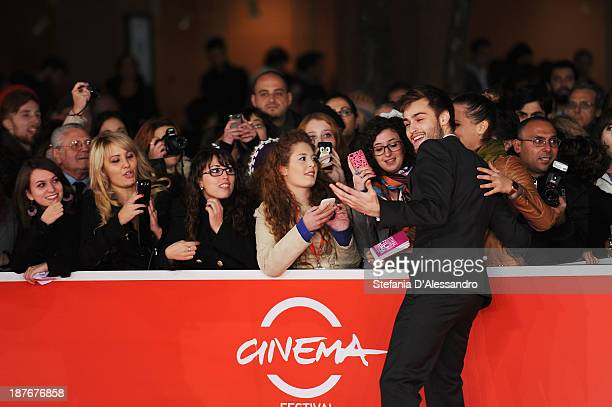 Douglas Booth has his picture taken with fans attending 'Romeo And Juliet' Premiere during The 8th Rome Film Festival on November 11 2013 in Rome...
