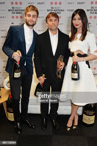 Douglas Booth Richard Linklater winner of the Best International Independent Film award for 'Boyhood' and Gemma Chan pose at The Moet British...
