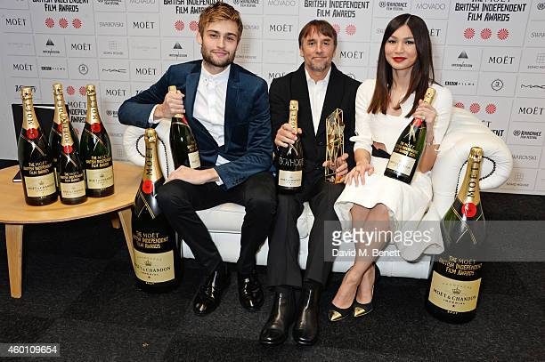 Douglas Booth Richard Linklater winner of the Best International Independent Film award for 'Boyhood' and Gemma Chan pose at The Moet British...