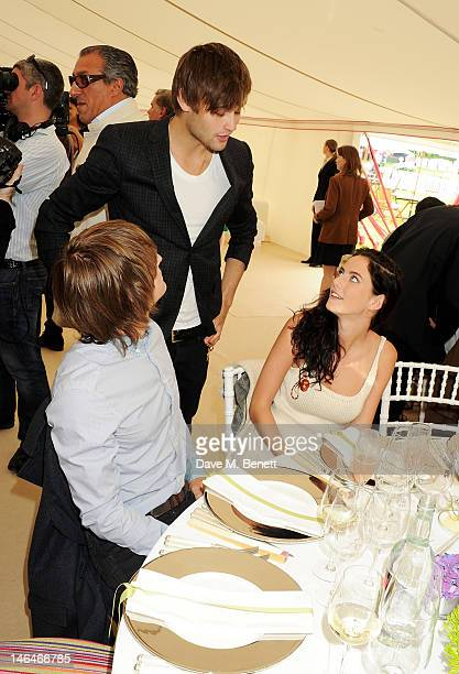 Douglas Booth speaks with Kaya Scodelario and Elliott Tittensor at the Cartier Queen's Cup Polo Day 2012 at Guards Polo Club on June 17 2012 in Egham...