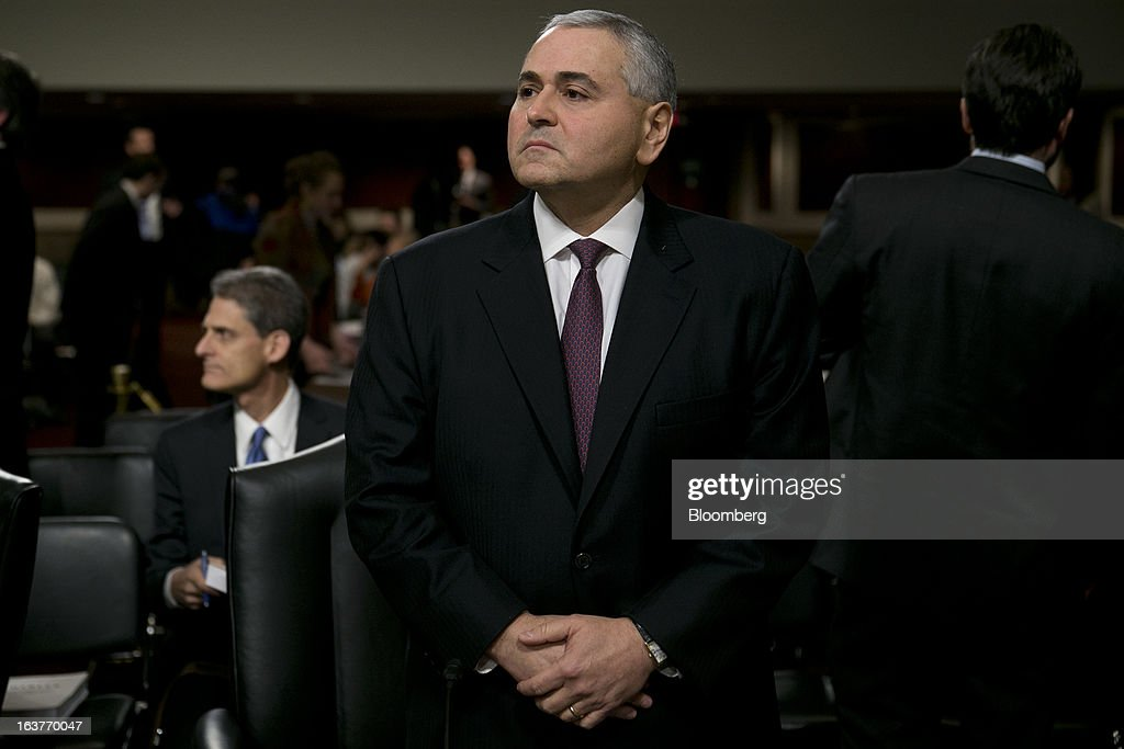 Douglas Braunstein, vice chairman of JPMorgan Chase & Co., arrives to a Senate Permanent Subcommittee on Investigations hearing in Washington, D.C., U.S., on Friday, March 15, 2013. JPMorgan Chase, the biggest U.S. bank by assets, compensated chief investment office traders in a way that encouraged risk-taking before the unit amassed losses exceeding $6.2 billion, a Senate committee said. Photographer: Andrew Harrer/Bloomberg via Getty Images