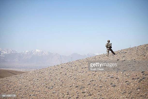 Douglas Carroll from Alma Georgia with the US Army's 2nd Battalion 87th Infantry Regiment 3rd Brigade Combat Team 10th Mountain Division patrols...
