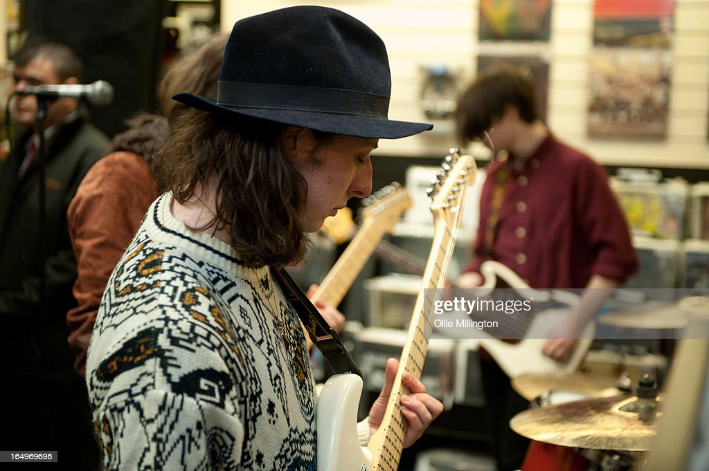 Douglas Castle and Sam Koisser of Peace perform at their instore gig at Head Records to promote the release of their debut album 'In Love' on March 29, 2013 in Leamington Spa, England.