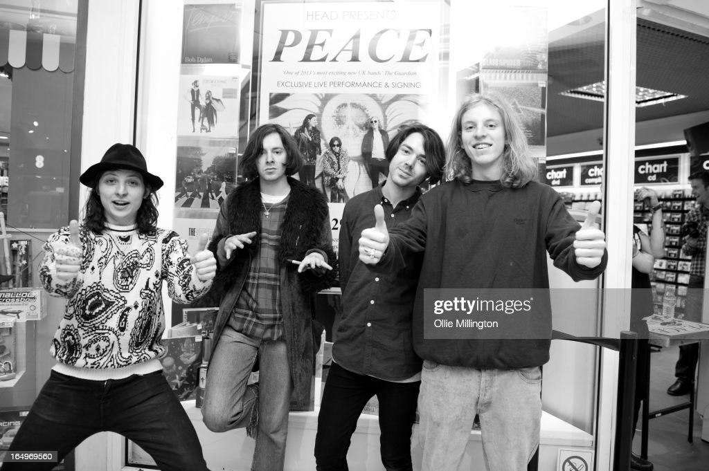 Douglas Castle, Harrison Koisser, Sam Koisser and Dominic Boyce of Peace pose for a photograph after their instore gig at Head Records to promote the release of their debut album 'In Love' on March 29, 2013 in Leamington Spa, England.