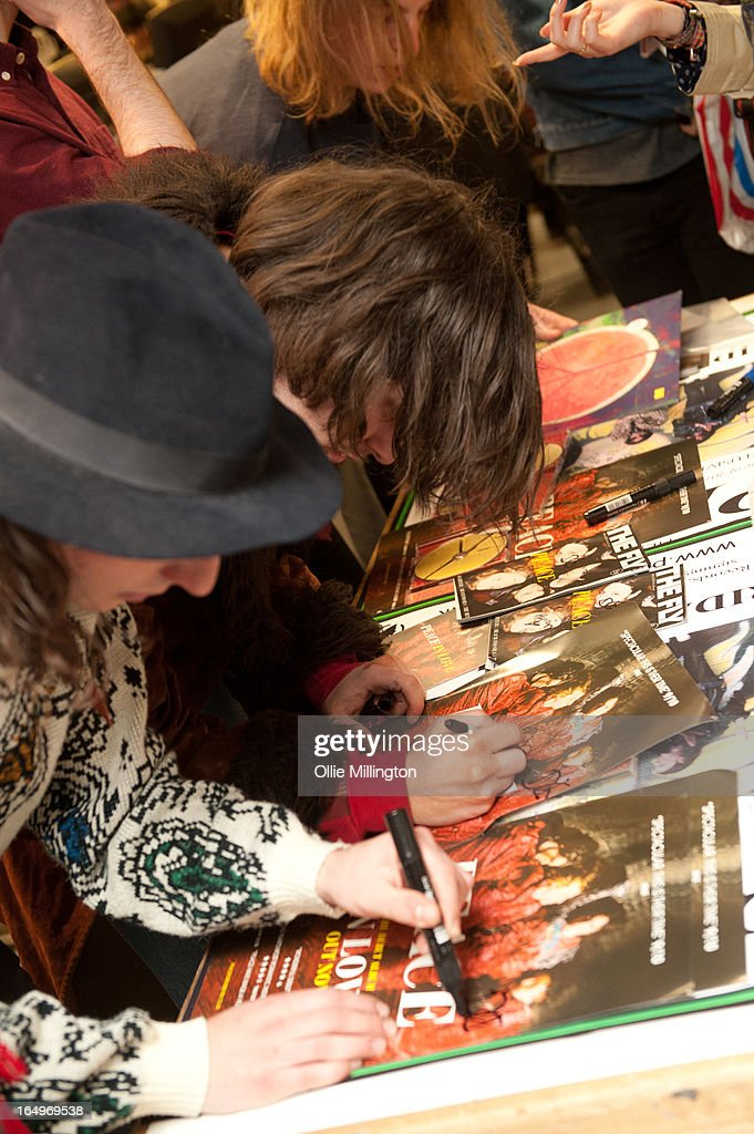 Douglas Castle, Harrison Koisser, Sam Koisser and Dominic Boyce of Peace meet fans and sign merchandise after their instore gig at Head Records to promote the release of their debut album 'In Love' on March 29, 2013 in Leamington Spa, England.