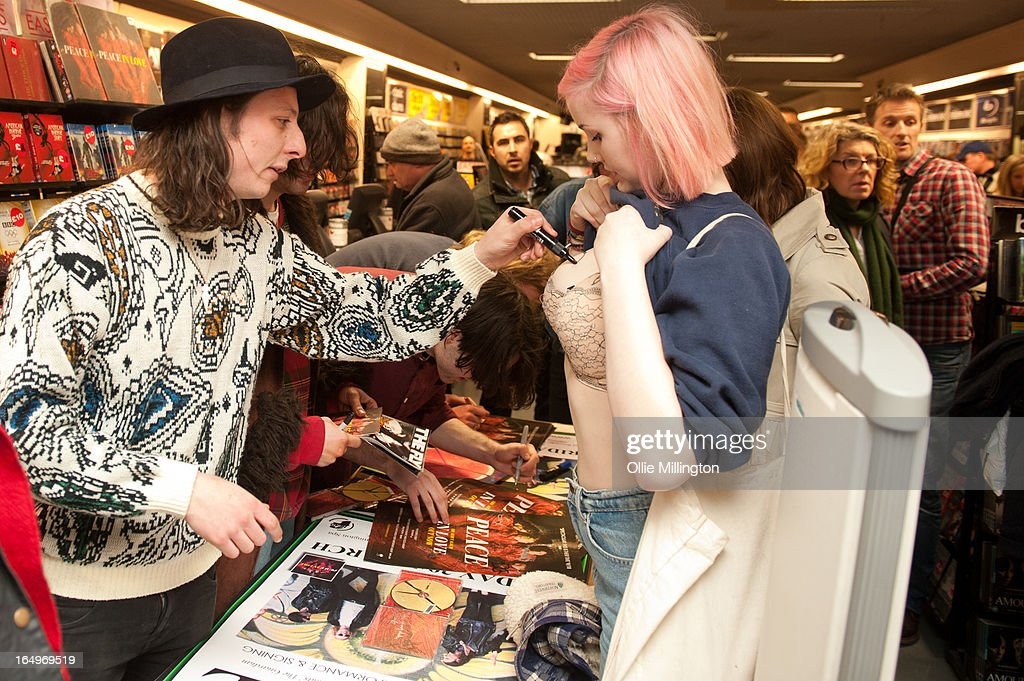 Douglas Castle of Peace signs a fan after their instore gig at Head Records to promote the release of their debut album 'In Love' on March 29, 2013 in Leamington Spa, England.