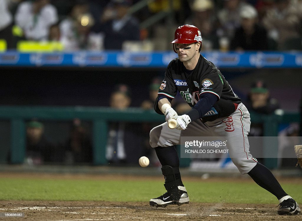 Douglas Clark of Yaquis de Obregon of Mexico lays down a bunt against Criollos de Caguas of Puerto Rico during the 2013 Caribbean baseball series on February 6, 2013 in Hermosillo in the northern Mexican state of Sonora. The Mexican team won 10-0. AFP PHOTO/Ronaldo Schemidt