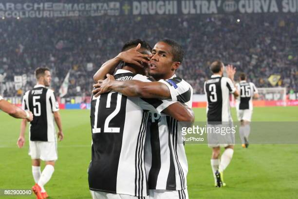 Douglas Costa and Alex Sandro celebrate after che goal of Mario Mandzukic during the UEFA Champions League football match between Juventus FC and...