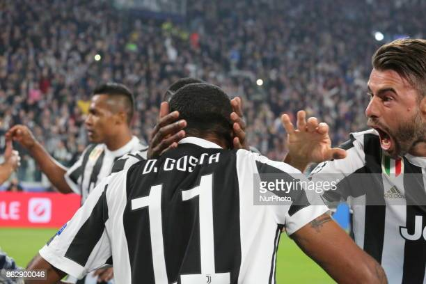 Douglas Costa and Andrea Barzagli celebrate after che goal of Mario Mandzukic during the UEFA Champions League football match between Juventus FC and...